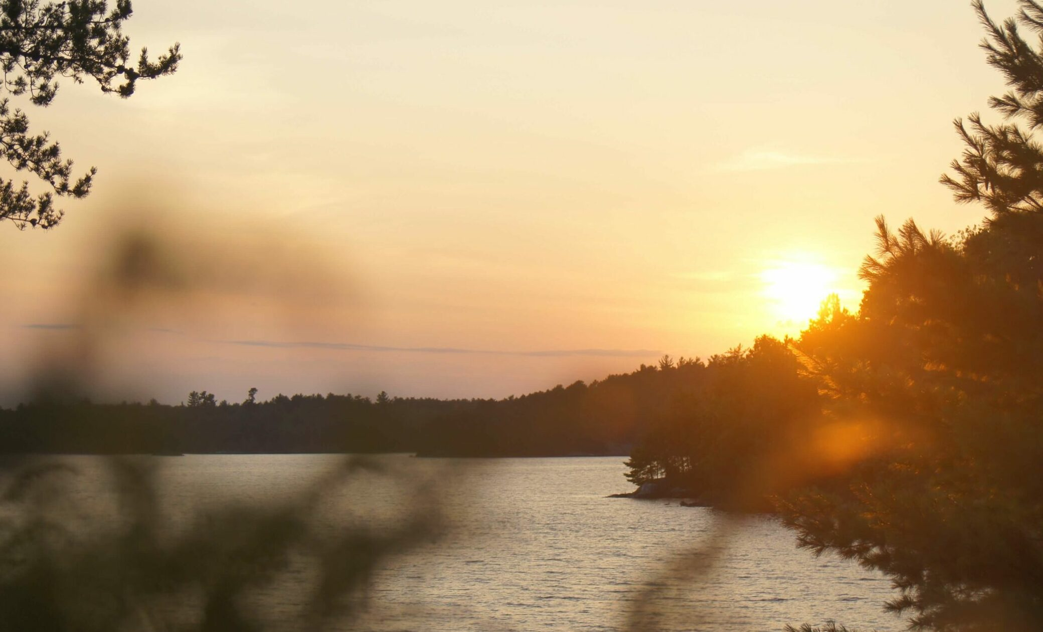 the sun coming over a horizon at Voyageurs National Park