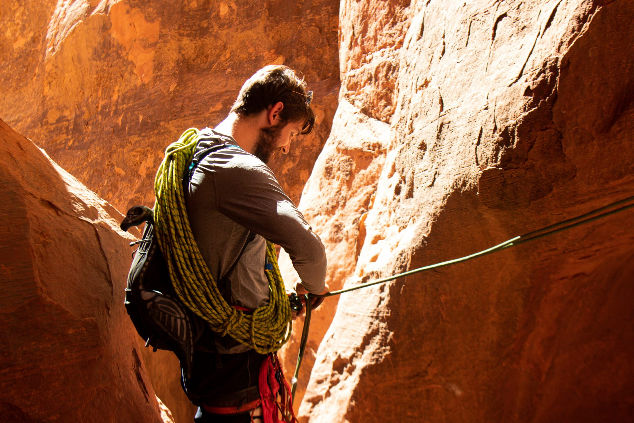 a family hiking in canyonlands national park with hiking gear